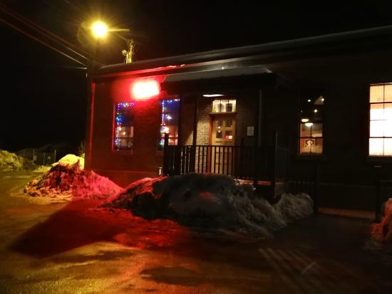 Elixir Restaurant: The entrance at night