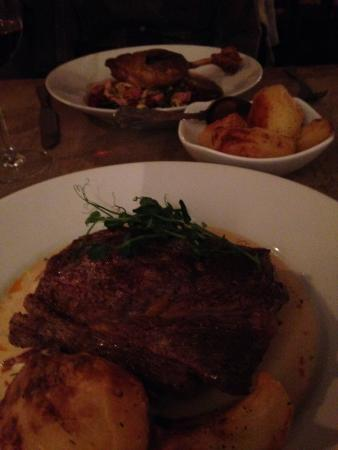 The Mews: Lovely slab of steak - perfectly cooked (duck leg in background)