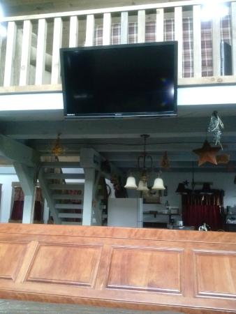 Premier Carriage House Cottages: View from huge king sleigh bed.  The large flat screen was perfect!