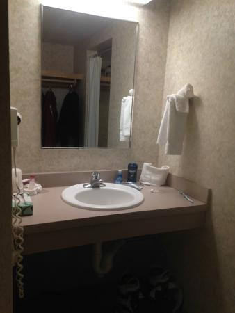 Hillside Inn at Killington : bathroom sink, across from coat area, toilet to left shower area to right