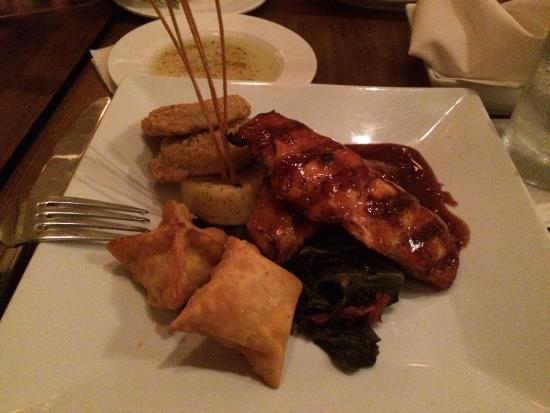 BIN112: BBQ Salmon with Fried Green Tomatoes, fried Bleu Cheese Dumplings and Grits Cake. Yum!
