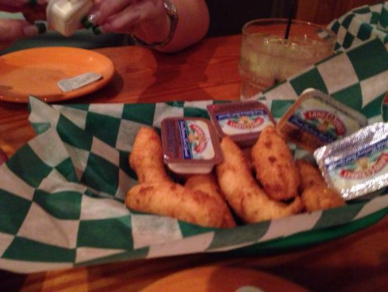 Sammy's Seafood House & Oyster Bar : The complimentary basket of very delicious hush puppies and butter.