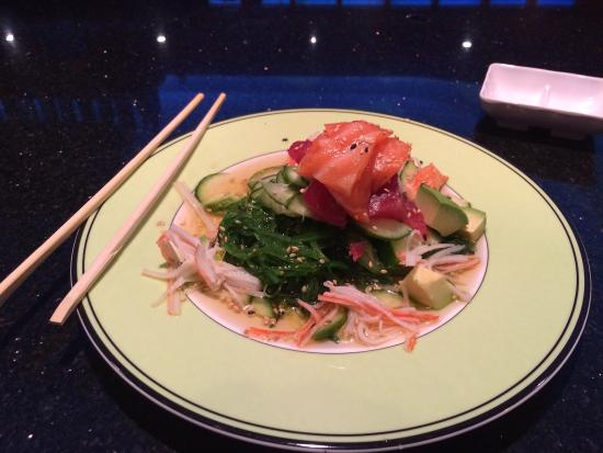 Okada: Sunomono salad with tuna, salmon. And more mixed w seaweed salad- yummy!!