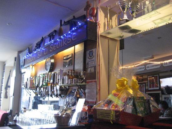 George's Bar: Wall behind bar