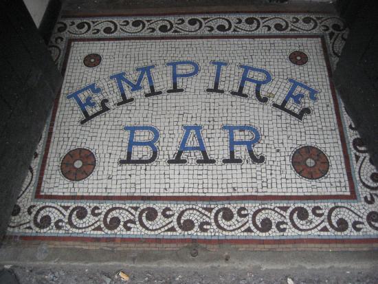 George's Bar: Tiles outside door