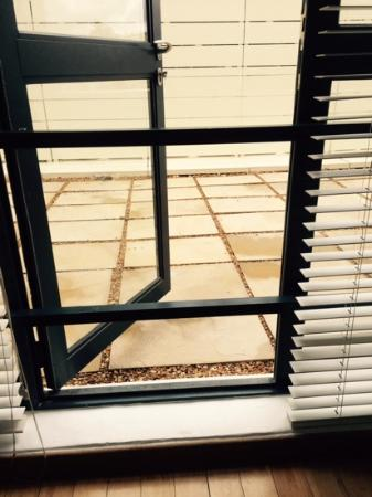 The Bars Across The Patio Door At Ivy Apartment Number 8 Picture