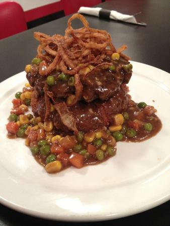 The Downtown Diner: Shepperd's Pie Burger..Our burger patty atop a panko crusted potato pancake, veggies and dark gr