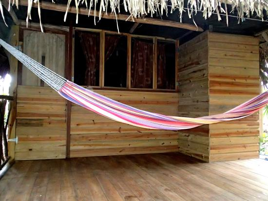 Yaxche Jungle Camp: porch for cabanas with hammocks