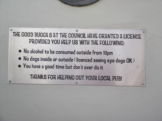 Pub On Wharf: Humorous licence message on the wall