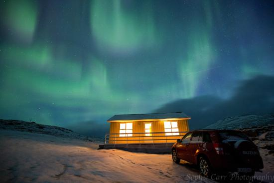 Stafafell: Northern lights over yellow cottage on a February morning!
