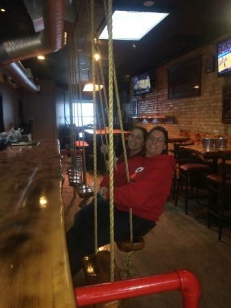 Papa Lou's : The bar stools are swings suspended from an overhead beam.