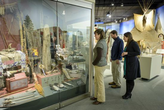 Cultural Heritage Center: Visitors taking a closer look at the artifacts on display in the Oyate Tawicoh'an Gallery.
