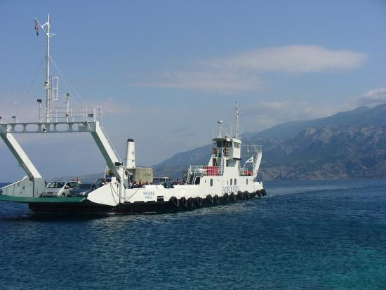Prizna, Croatia: The ferry about to dock at Zigljen (Pag) on a beautiful June morning: the mainland on the backgr