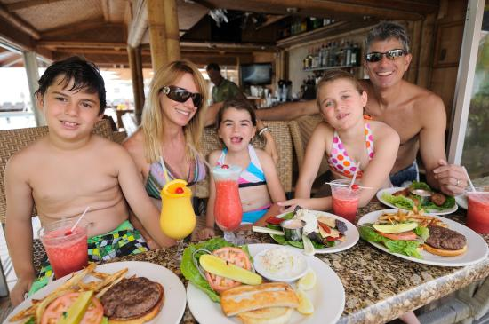 Beachcomber Resort and Villas: A happy family enjoying lunch poolside