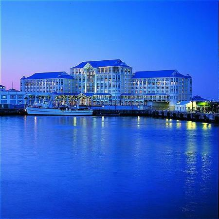 The Table Bay Hotel at night from the port