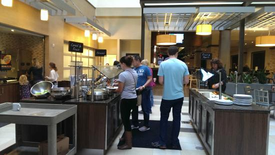 Embassy Suites by Hilton Dallas - Market Center: People scronging for food. You can see the cart in the lower left.