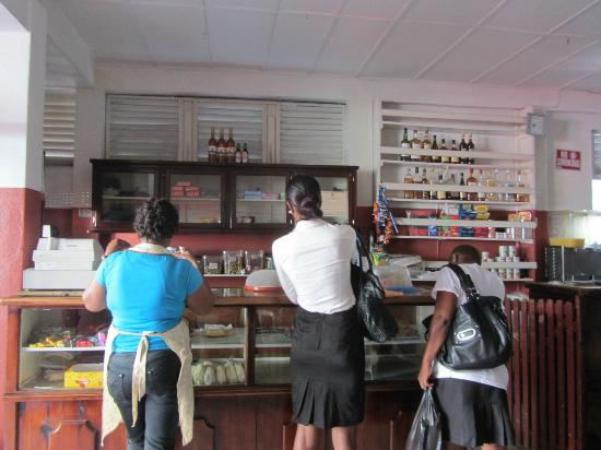 Purity Bakery : Patrons awaiting a new batch of bread to come out from the kitchen