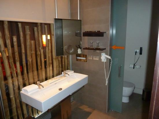 View Of The Bathroom Sink And Toilet Nook In Background Picture Of
