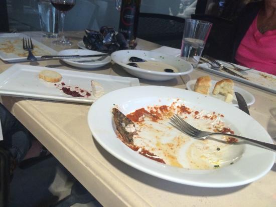 Amuse Bouche: Empty plates of Scallops and Barramundi