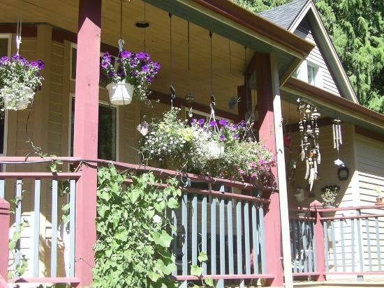 The Artist and The Quiltmaker - Victorian B & B : Hanging baskets adorn wrap-around deck