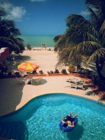 Castillito Kin-Nah: My fiance floating in the pool (view from our room)