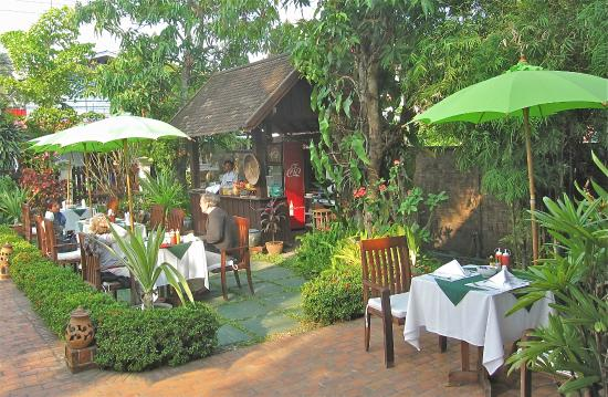 Luang Prabang Residence: garden area with tables