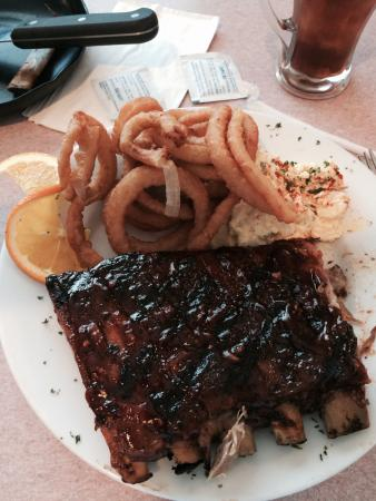 JimEddie's: Half rack of ribs with a side of Potato Salad and Onion Rings