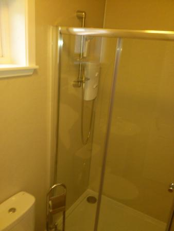 High Range Self-catering Chalets: Bathroom. Small. Loose shower head.