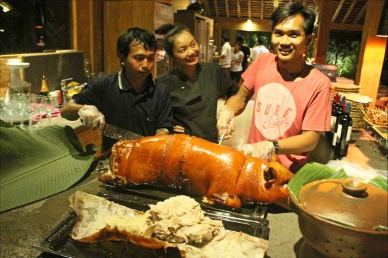 Image result for Bali is a Hindu island whose signature dish is a roast pig.