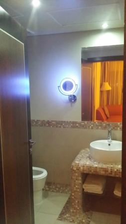 Al Raya Suites: the sink light is so faint (much darker than what is shown)