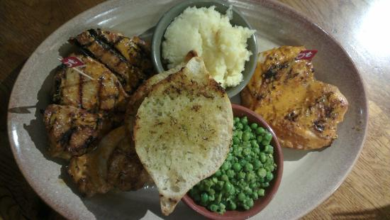 Nando's: chicken platter with 4 side dishes costs 19.55£ to be shared between 2 people