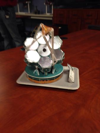 University of Arizona: Small model of the telescope. The actual disks will be 8 meters across. There are seven of them.