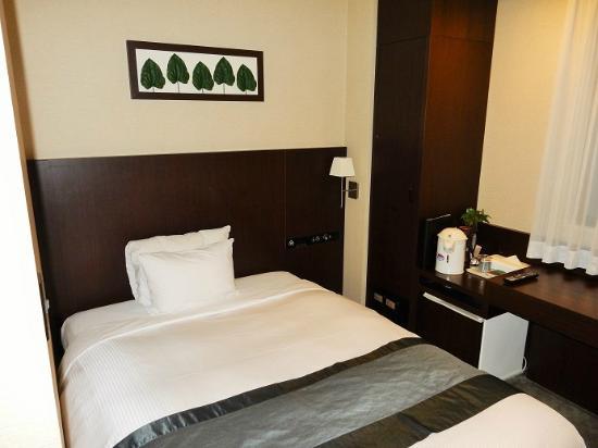 Hotel Riverge Akebono: シングルルームベッド