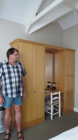 "Aan Dorpstraat Guest House: Johan 1.96 m (6'5"") tall next to wardrobe"