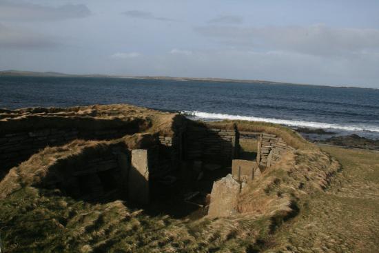 The Knap O' Howar: Smaller House with Westray in background, Knap O' Howar