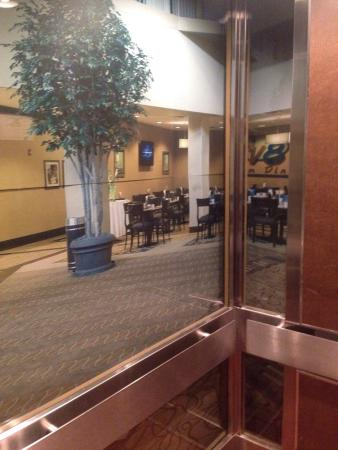 Holiday Inn Little Rock-Airport-Conf Ctr: Inside the glass elevator, there is a wall sized picture of the lobby. It's almost as if you're