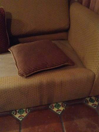 Las Rocas Resort & Spa: The nasty stained couch  in our $129 Las Rocas Suite.