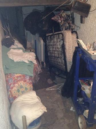 Las Rocas Resort & Spa: The nasty N A S T Y storage room where I found a pillow (there on the left) after manager told u