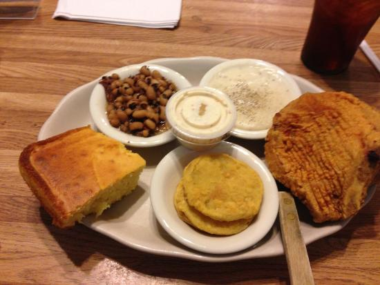 PoFolks: Fried PorkChops w/gravy' fried green tomatoes, blacked peas and cornbread