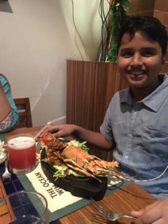 Barbeque Nation: My son enjoying lobster during the sea food festival...