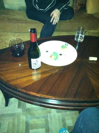 The remnants of their complimentary wine and fruit plate