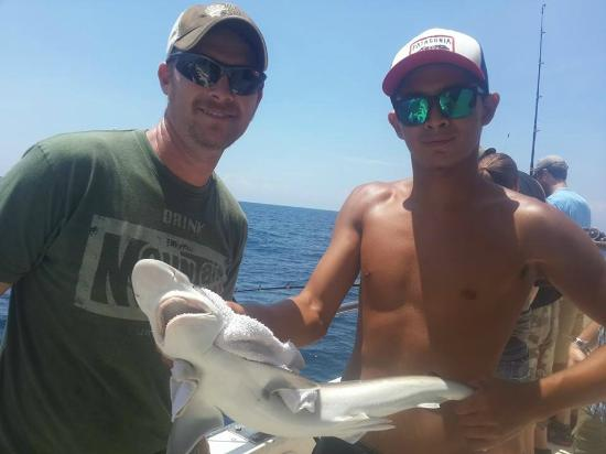 My husband on the left with his thresher shark picture for Majesty deep sea fishing