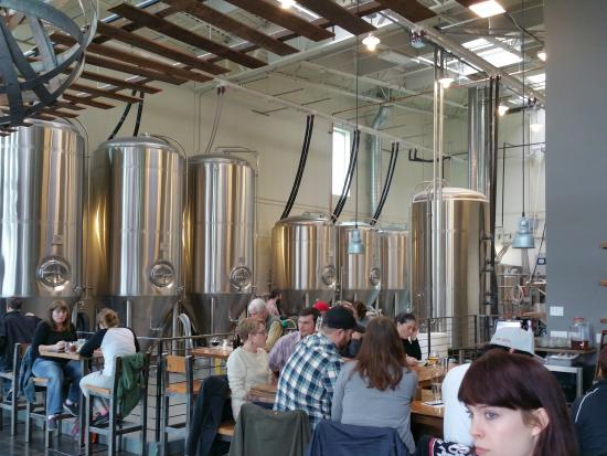 pFriem Family Brewers: Shot of the Pfriem Brewing tanks from in front of the bar