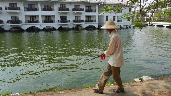 InterContinental Hanoi Westlake : Local fisherman.  Hotel in Background