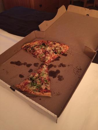 Gnarly Roots Pizza Cafe: Here is what's left of our pizza so far! Very tasty