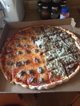 Sammy's Pizza & Restaurant: Another awesome Sammys pizza!! Looks & taste identical to the original owners. Beef, sausage, cr