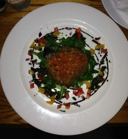 The Roadside Tavern: Goat cheese ball atop fresh greens and diced vegetables.