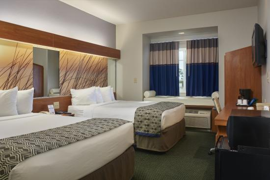 Microtel Inn & Suites by Wyndham Port Charlotte: Guest Room with two queen sized beds, flat screen HDTV, mini fridge and microwave, coffee maker.