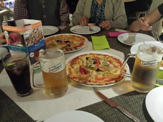 Caruso : Cold beer and pizza