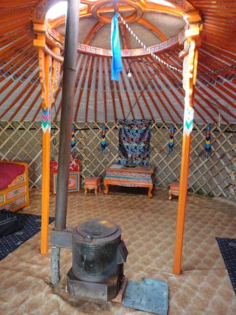 Jalman Meadows Wilderness Camp: Inside the ger, wood-burning stove in the middle. The beds are to either side. There was also a